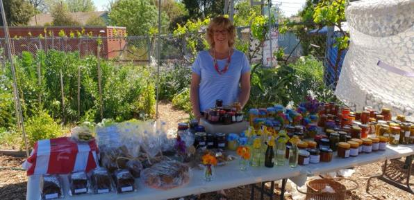 Pam presiding over the home jams and home baked goods