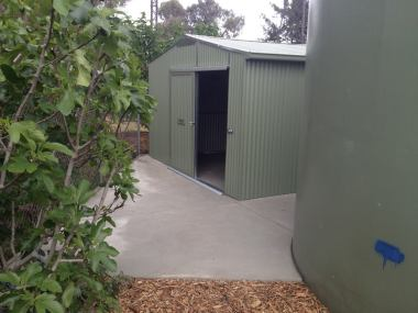 The new shed tucks in behind the rainwater tank